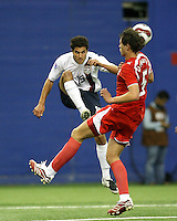 Sal Zizzo lifts the ball over Krysztof Strugarek in first half action. USA and Poland met in the second game in group D of the FIFA U-20 World Cup at the Parc Olympique in Montreal on July 3 2007.