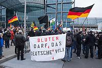 """Etwa 2.000 rechtsradikale Menschen demonstrierten am Samstag den 12. Maerz 2016 in Berlin unter dem Motto """"Merkel muss weg!"""" gegen Angela Merkel, gegen Fluechtlinge und fuer """"Das deutsche Vaterland"""".<br /> Bis auf wenige Ausnahmen waren angereisten Teilnehmer Neonazis und Hooligans, NPD-, Pediga- und AfD-Mitglieder.<br /> Aufgerufen zu dem Aufmarsch hatten die Hooligan-Gruppen """"Buendnis fuer Deutschland"""" und """"Buendnis fuer Berlin"""".<br /> Im Bild: Teilnehmer halten ein Transparent mit der Aufschrift """"Bluten darf das Deutsche Volk"""".<br /> 12.3.2016, Berlin<br /> Copyright: Christian-Ditsch.de<br /> [Inhaltsveraendernde Manipulation des Fotos nur nach ausdruecklicher Genehmigung des Fotografen. Vereinbarungen ueber Abtretung von Persoenlichkeitsrechten/Model Release der abgebildeten Person/Personen liegen nicht vor. NO MODEL RELEASE! Nur fuer Redaktionelle Zwecke. Don't publish without copyright Christian-Ditsch.de, Veroeffentlichung nur mit Fotografennennung, sowie gegen Honorar, MwSt. und Beleg. Konto: I N G - D i B a, IBAN DE58500105175400192269, BIC INGDDEFFXXX, Kontakt: post@christian-ditsch.de<br /> Bei der Bearbeitung der Dateiinformationen darf die Urheberkennzeichnung in den EXIF- und  IPTC-Daten nicht entfernt werden, diese sind in digitalen Medien nach §95c UrhG rechtlich geschuetzt. Der Urhebervermerk wird gemaess §13 UrhG verlangt.]"""
