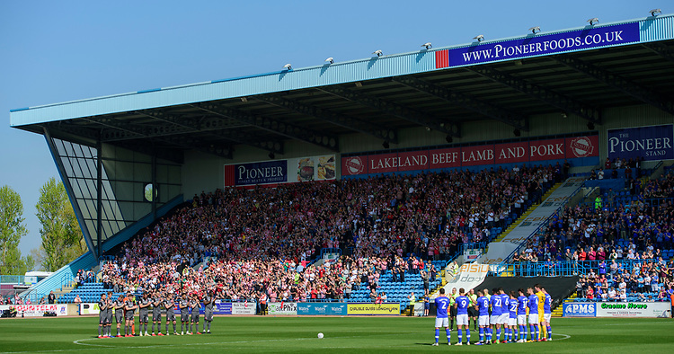 Lincoln City players and fans and Carlisle United players during a minutes applause, in memory of Ivor Broadis<br /> <br /> Photographer Chris Vaughan/CameraSport<br /> <br /> The EFL Sky Bet League Two - Carlisle United v Lincoln City - Friday 19th April 2019 - Brunton Park - Carlisle<br /> <br /> World Copyright © 2019 CameraSport. All rights reserved. 43 Linden Ave. Countesthorpe. Leicester. England. LE8 5PG - Tel: +44 (0) 116 277 4147 - admin@camerasport.com - www.camerasport.com