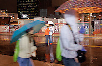 Natalie Herzberg, 21, of St. Charles, and Mike Davis, 23, of Bellefontaine, share an umbrella in the middle of Clark St. outside of Busch Stadium while waiting for the rain delay in game 6 of the World Series against the Detroit Tigers on Thursday, October 25, 2006. Davis said the street was packed with people and lawn chairs yesterday and the two wanted to be sure they got a good spot. The game was ultimately postponed.