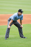 Carolina League umpire Adam Beck handles the calls on the bases during the game between the Frederick Keys and the Winston-Salem Dash at BB&T Ballpark on May 18, 2014 in Winston-Salem, North Carolina.  The Dash defeated the Keys 7-6.  (Brian Westerholt/Four Seam Images)