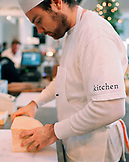 USA, California, Los Angeles, chef preparing a cheese block in kitchen at Joan's On Third.
