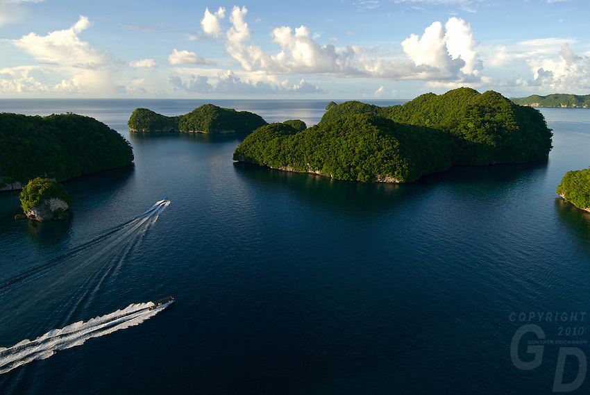 Aerial view of the Rock Islands in the late afternoon,boats returning from diving Palau, <br /> Micronesia