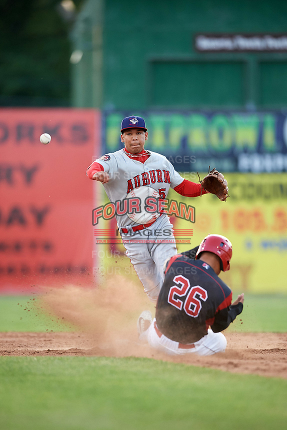 Auburn Doubledays shortstop Andres Martinez (5) turns a double play as Rony Cabrera (26) slides into second base during a game against the Batavia Muckdogs on June 19, 2017 at Dwyer Stadium in Batavia, New York.  Batavia defeated Auburn 8-2 in both teams opening game of the season.  (Mike Janes/Four Seam Images)