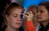 Face Painting at the Australian Open..International Tennis - Australian Open Tennis - Mon 18 Jan 2010 - Melbourne Park - Melbourne - Australia ..© Frey - AMN Images, 1st Floor, Barry House, 20-22 Worple Road, London, SW19 4DH.Tel - +44 20 8947 0100.mfrey@advantagemedianet.com