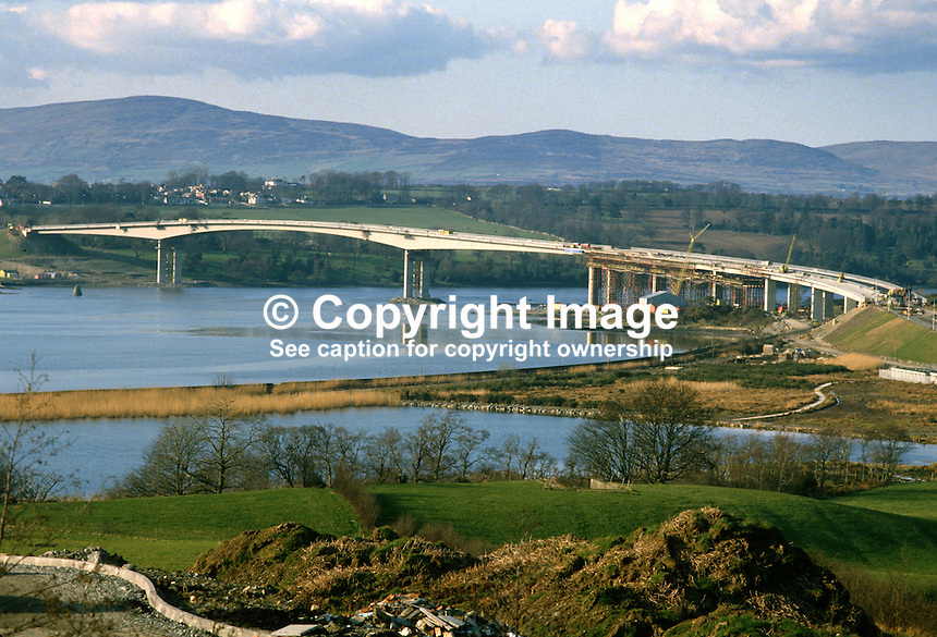 Final stages of construction at the New Foyle Bridge over the River Foyle, north of Londonderry, N Ireland. March 1984. Donegal Mountains are in the distance.  19840036FB1..Copyright Image from Victor Patterson, 54 Dorchester Park, Belfast, UK, BT9 6RJ..Tel: +44 28 9066 1296.Mob: +44 7802 353836.Voicemail +44 20 8816 7153.Skype: victorpattersonbelfast.Email: victorpatterson@me.com.Email: victorpatterson@ireland.com (back-up)..IMPORTANT: If you wish to use this image or any other of my images please go to www.victorpatterson.com and click on the Terms & Conditions. Then contact me by email or phone with the reference number(s) of the image(s) concerned.