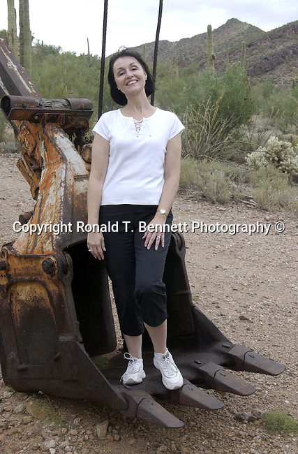 Michelle Bennett in steam shovel, steam shovel, mine, gold mine,Gold mining ghost town, ghost town, Gold mining, gold, goldmine, remove gold, wheels from gold mine, Mining equipment, gold panning, open pit, gold extraction, gold rush, gold prospecting, ore, ore genesis, placer mining,Arizona, State of Arizona, Southwest, desert, 48th State, Last of contiguous states, Phoenix, Scottsdale, Grand Canyon, Indian reservations, four corners, desert landscape, exrophyte, western United States, Southwest, Mountains, plateaus, ponderosa pines, Colorado River,  Mountain lion, Navajo Nation, No daylight savings time, Arizona Territory, Arizona, AR, Ariz, Airzona, Arizonia, Arizone, AZ, Fine Art Photography by Ron Bennett, Fine Art, Fine Art photography, Art Photography, Copyright RonBennettPhotography.com ©
