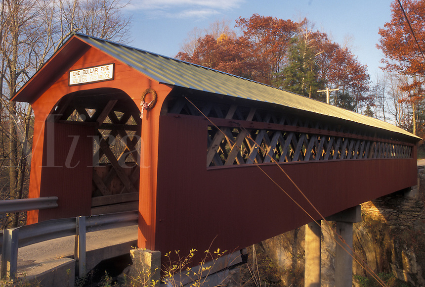 AJ4594, covered bridge, fall, Vermont, The red Chiselville Covered Bridge c.1870 spans across the river in Arlington in Bennington County in the state of Vermont during the autumn season.