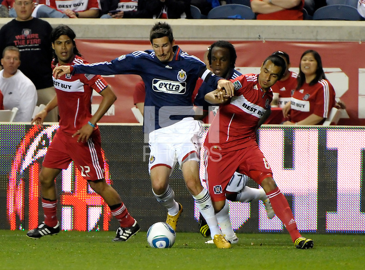 Chivas forward Sacha Kljestan (16) battles for the ball with Chicago midfielder Julio Martinez (6).  The Chicago Fire tied Chivas USA 1-1 at Toyota Park in Bridgeview, IL on May 1, 2010.