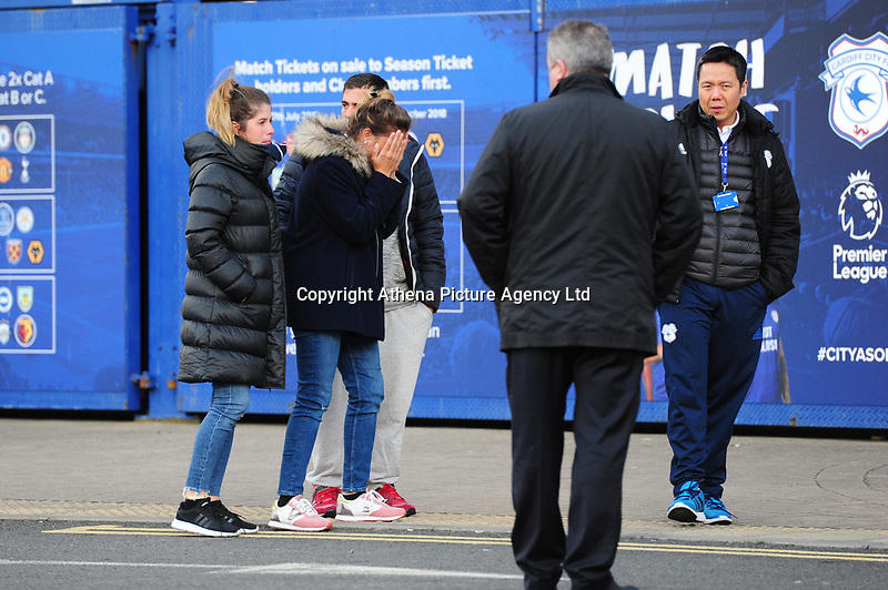 Pictured: Sala's sister Romina Sala (centre) pays tribute for Emiliano Sala laid down outside the Cardiff City Stadium in south Wales, UK. Friday 25 January 2019<br /> Re: Premier League footballer Emiliano Sala was on a flight which disappeared between France and Cardiff.<br /> The Argentine striker was one of two people on board the Piper Malibu, which disappeared off Alderney on Monday night.<br /> Cardiff City FC, signed the 28-year-old from French club Nantes.