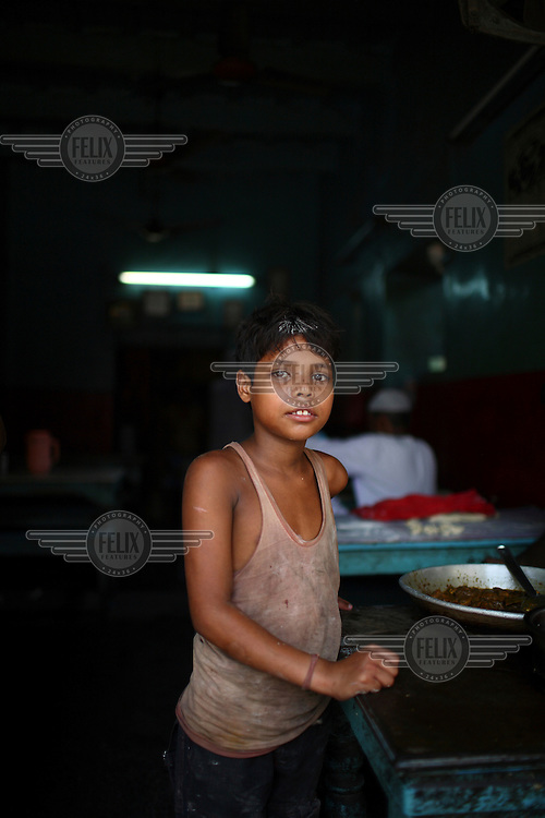Child working in a roadside restaurant in the new market area of Kolkata.