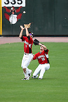 May 2, 2010:  Shortstop Trevor Plouffe (1) of the Rochester Red Wings catches a fly ball as Brian Dinkelman backs up during a game vs. the Durham Bulls at Frontier Field in Rochester, NY.  Rochester defeated Durham in extra innings by the score of 7-6.  Photo By Mike Janes/Four Seam Images
