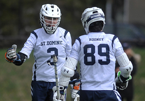 Jack Rooney #3, left, celebrates with brother Tommy Rooney #89 after teaming up for a St. Dominic goal in a varsity boys lacrosse game against Long Island Lutheran at Charles Wang Athletic Complex in East Norwich on Monday, April 30, 2018. Tommy, a senior, scored the goal while junior Jack assisted to give the Bayhawks a 6-0 lead in the first quarter.