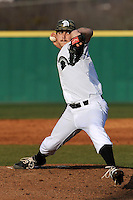 Starting pitcher Dylan Parker (12) of the University of South Carolina Upstate Spartans delivers a pitch in a game against the Winthrop University Eagles on Wednesday, March 4, 2015, at Cleveland S. Harley Park in Spartanburg, South Carolina. Upstate won, 12-3. (Tom Priddy/Four Seam Images)