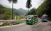 May 3rd, 2011_Shangri-La, Yunnan, China_ Electric cars are used to shuttle tourists inside the Qingcheng Lianghe Mountain Village area in Sichuan Province, China.  Qingcheng is located near Chengdu and is an example of recent trends in China's tourism industry.  Photographer: Daniel J. Groshong/The Hummingfish Foundation