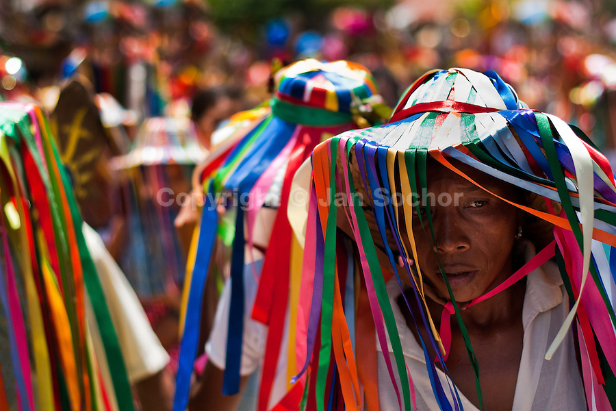 """A Negritas dancer with colorful ribbons on a hat takes part in the religious procession in Atanquez, Sierra Nevada, Colombia, 3 June 2010. A colorful celebration of Corpus Christi is held in the Kankuamo Indians territory every year. """"The Dance of the Devils"""" is an ancient tradition kept for centuries on the Colombia's Caribbean coast. This Christian religious event usually coincides with the summer solstice, which has always been the key point for the native cultures and for the black African slaves. Due to this confluence, the Kankuamo myths, the African animistic rites and other Pre-Columbian features have blended with the Spanish Catholic festival into a lively spectacle."""