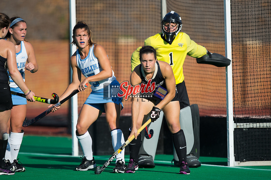 Jessy Silfer (4) of the Wake Forest Demon Deacons works to move Sam Night (5) of the North Carolina Tar Heels from in front of he goal during second half action at Kentner Stadium on October 23, 2015 in Winston-Salem, North Carolina.  The Demon Deacons defeated the Tar Heels 3-2.  (Brian Westerholt/Sports On Film)