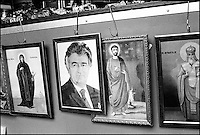 Icons in the open-air market. The second from the left is Radovan Karadzic. Karadzic is the former ruler of the Serbian Republic in Bosnia-Herzegovina, as well as the number one wanted war criminal from the civil war in ex-Yugoslavia. New Blegrade, Serbia, Yugoslavia February 2001 &copy; Stephen Blake Farrington<br />