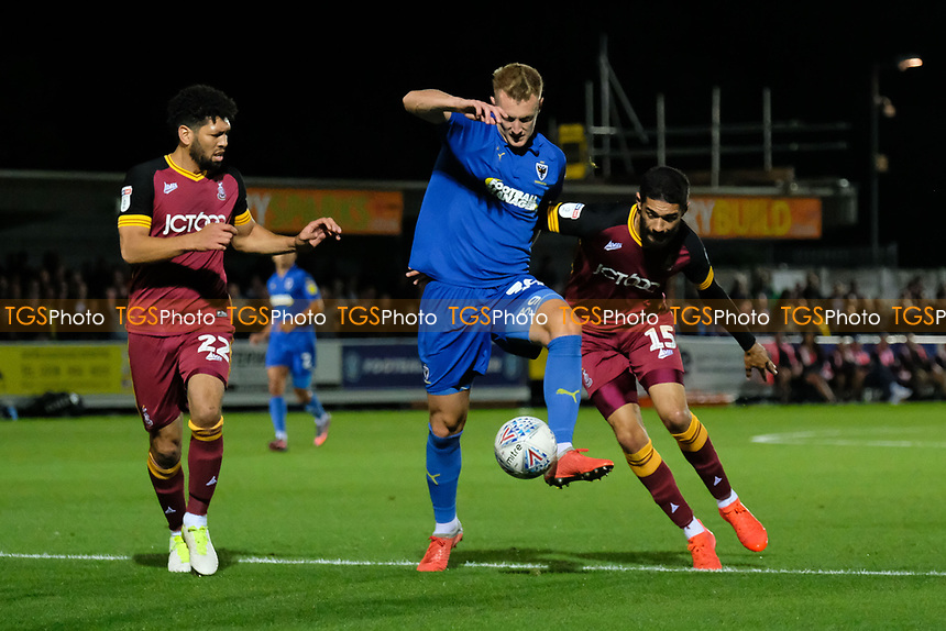 Nathaniel Knight-Percival (left) of Bradford City, Joe Pigott (centre) of AFC Wimbledon and Kelvin Mellor of Bradford City during AFC Wimbledon vs Bradford City, Sky Bet EFL League 1 Football at the Cherry Red Records Stadium on 2nd October 2018