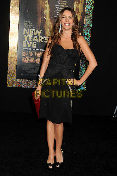 Sofia Vergara.'New Year's Eve' Los Angeles premiere at  Grauman's Chinese Theatre, Hollywood, California, USA..5th December 2011.full length dress hand on hip shoulder red clutch bag black strapless corset  .CAP/ADM/BP.©Byron Purvis/AdMedia/Capital Pictures.