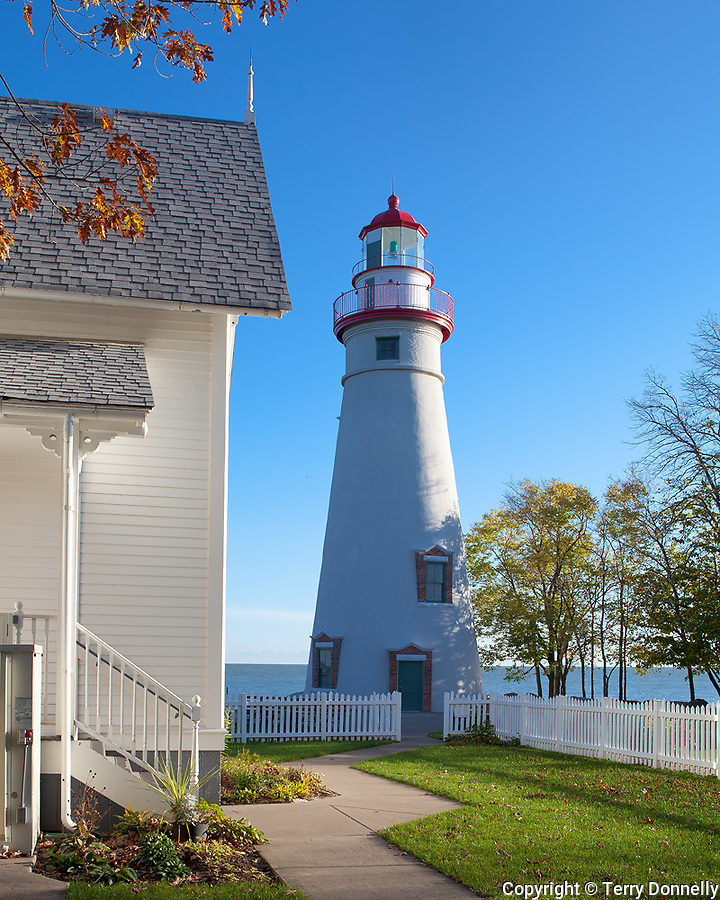 Marblehead Lighthouse State Park, OH<br /> Morning sun on Marblehead Lighthouse (1819) and Lake Erie, oldest lighthouse in continuous operatoin on the great lakes