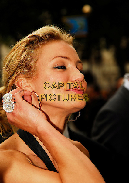 "CAMERON DIAZ.Attending the UK Premiere of ""Shrek The Third"",.Odeon Leicester Square, London, England,.June 11th 2007..portrait headshot funny hand ring.CAP/IA.©Ian Allis/Capital Pictures"