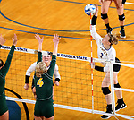 BROOKINGS, SD - SEPTEMBER 24: Makenzie Hennen #3 from South Dakota State looks to get a kill past Brianna Rasmusson #4 from North Dakota State during their match Sunday evening at Frost Arena in Brookings. (Photo by Dave Eggen/Inertia)