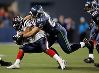 SEATTLE--Houstons #37 Domanick Davis runs the ball as he is taken down by Lofa Tatupu during Texans vs. Seattle Seahawks at Qwest Field on Sunday Oct. 16, 2005. (Kevin P. Casey/Wireimage.com)