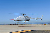 An MQ-8C Fire Scout unmanned aerial vehicle takes off from Naval Base Ventura County at Point Mugu, California.  The United States Navy's newest variant of the Fire Scout unmanned helicopter completed its first day of flying October 31, 2013 with two flights reaching 500 feet altitude. The MQ-8C air vehicle upgrade will provide longer endurance, range and greater payload capability than the MQ-8B. Initial operating capability for the MQ-8C is planned for 2016, with the potential for an early deployment in 2014. <br /> Credit: U.S. Navy Photo Courtesy of Northrop Grumman via CNP