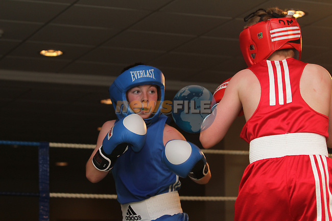 Derek Maguire, Holy Family (RED) and Pearse O'Leary, Docklands (BLUE) at the Holy Family Boxing Club Annual Show in The Boyne Valley Hotel...(Photo Jenny Matthews/www.golffile.ie)