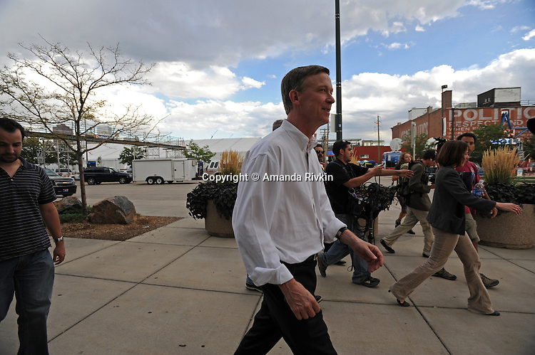 John Hickenlooper, mayor of Denver, Colorado, enters the Pepsi Center, site of the Democratic National Convention, for the hall's opening in Denver, Colorado on August 22, 2008.  The Democratic National Convention officially kicks off Monday August 25, 2008 at the nearby Pepsi Center.