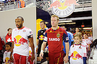 Thierry Henry (14) of the New York Red Bulls and Nat Borchers (6) of Real Salt Lake lead their teams onto the field. Real Salt Lake defeated the New York Red Bulls 3-1 during a Major League Soccer (MLS) match at Red Bull Arena in Harrison, NJ, on September 21, 2011.