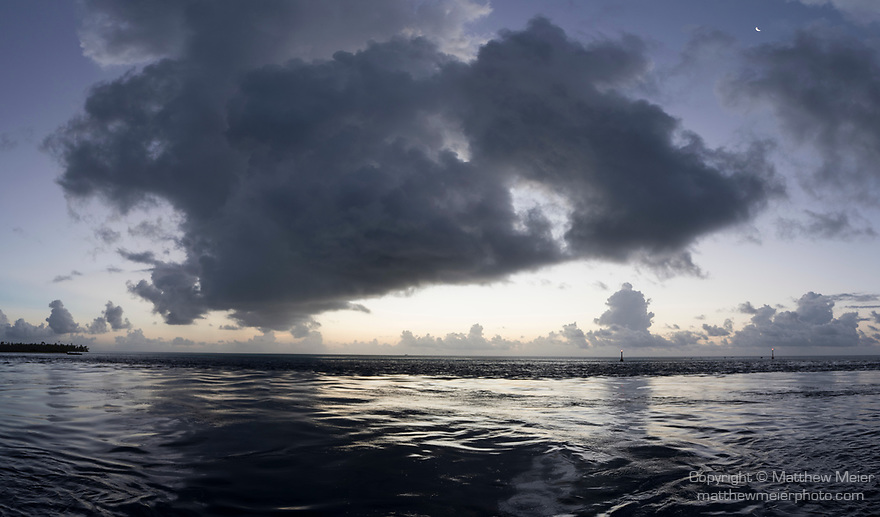 Fakarava Atoll, Tuamotu Archipelago, French Polynesia; a panoramic view of sunset clouds over the Tetamanu Pass from the docks of Tetamanu Village