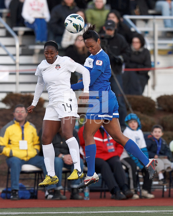Washington Spirit forward Tiffany McCarty (14) and Boston Breakers defender Kia McNeill (14) battle for head ball.  In a National Women's Soccer League Elite (NWSL) match, the Boston Breakers (blue) tied the Washington Spirit (white), 1-1, at Dilboy Stadium on April 14, 2012.