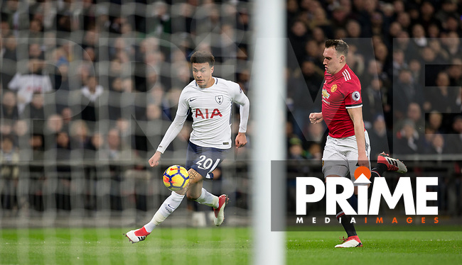 Dele Alli of Spurs & Phil Jones of Man Utd during the Premier League match between Tottenham Hotspur and Manchester United at Wembley Stadium, London, England on 31 January 2018. Photo by Andy Rowland.