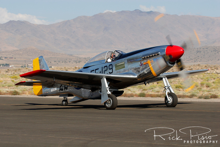 "Stuart Eberhardt taxies his North American Aviation built P-51 Mustang ""Merlin's Magic"" along the ramp at Stead Field, Nevada. The Mustang is considered by many to be the premier fighter of World War II. Stuart has campaigned Merlin's Magic at the Reno National Championship Air Races regularly since purchasing the aircraft in 1986.  Photographed 09/07"