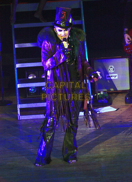 ADAM LAMBERT.performs for a sold-out crowd at the Ryman Auditorium, Nashville, TN, USA, .7th July, 2010..music live on stage concert gig full length black jacket microphone singing fur coat hat glitter fingerless gloves tassels shiny fringed  bare foot feet barefoot .CAP/ADM/RR.©Randi Radcliff/AdMedia/Capital Pictures.
