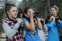 NWA Democrat-Gazette/FLIP PUTTHOFF <br /> SPRING BREAK BIRDS<br /> Kelsey Campbell (from left) and Erika Banks look at birds Wednesday March 23, 2016 before making drawings of them during Spring Break Day Camp at Hobbs State Park-Conservation Area. Students take part in a variety of nature activities with guidance from Caitlin Mitchell, college intern (right) and Rebekah Penny, park interpreter. The park also hosted dozens of students from Camp War Eagle on Wednesday who did trail work on the Dutton Hollow Loop of the park's multiuse trail for hikers, horse-back riders and mountain bikers.