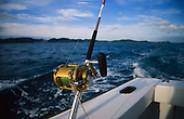 A big game fishing rod & reel on a boat heading out of the Bay of Islands to the fishing grounds. Northland, New Zealand.