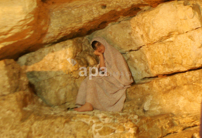 A Palestinian Muslim girl sits inside the Dome of the Rock at the Al-Aqsa Mosques compound in Jerusalem's Old City on Jun 23, 2011. Photo by Mahfouz Abu Turk