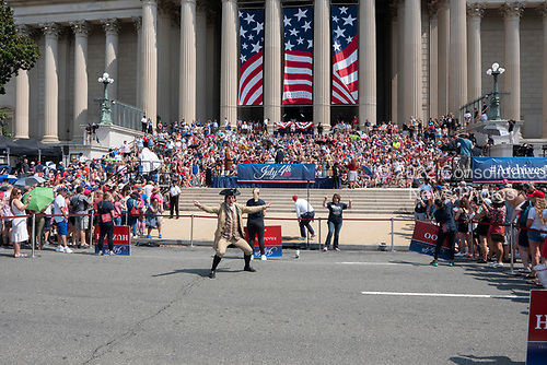 Re-enactors of the founding fathers read the Declaration of Independence outside the National Archives in Washington DC on July 4, 2019.<br /> <br /> Credit: Stefani Reynolds / CNP