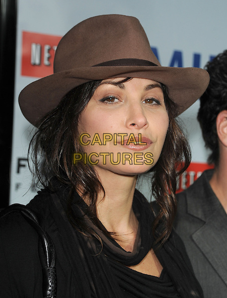 "GINA GERSHON.The Focus Features L.A. Premiere of ""MILK"" held at The Academy in Beverly Hills, California, USA. .November 13th, 2008                                                                     headshot portrait brown trilby fedora .CAP/DVS.©Debbie VanStory/Capital Pictures."