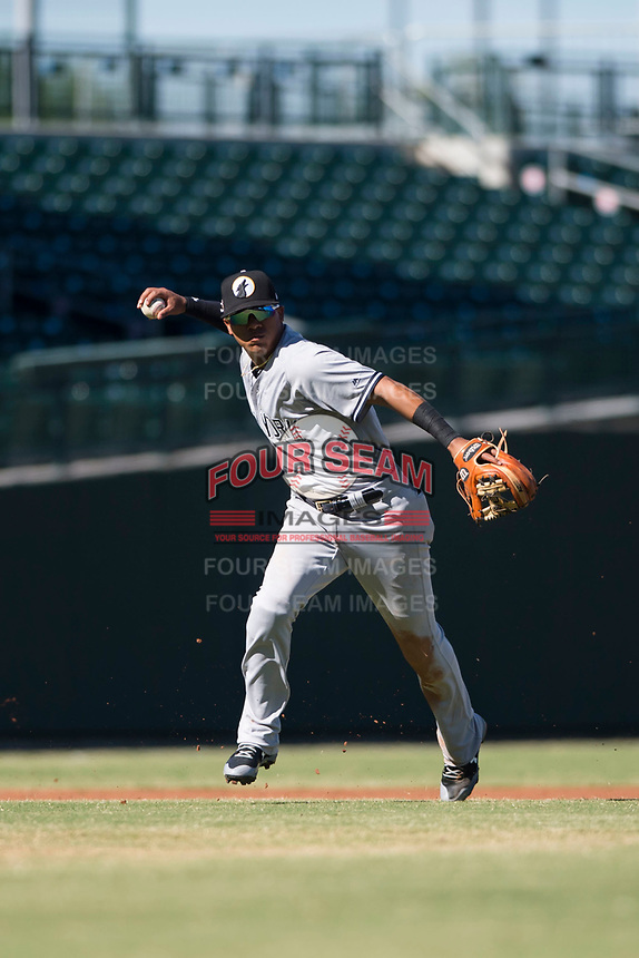 Glendale Desert Dogs shortstop Thairo Estrada (90), of the New York Yankees organization, throws to first base during an Arizona Fall League game against the Mesa Solar Sox at Sloan Park on October 27, 2018 in Mesa, Arizona. Glendale defeated Mesa 7-6. (Zachary Lucy/Four Seam Images)