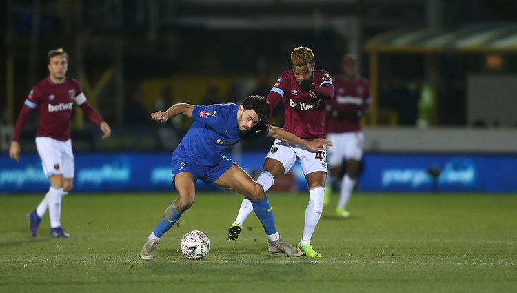 West Ham United's Grady Diangana and AFC Wimbledon's Will Nightingale<br /> <br /> Photographer Rob Newell/CameraSport<br /> <br /> Emirates FA Cup Fourth Round - AFC Wimbledon v West Ham United - Saturday 26th January 2019 - Kingsmeadow Stadium - London<br />  <br /> World Copyright © 2019 CameraSport. All rights reserved. 43 Linden Ave. Countesthorpe. Leicester. England. LE8 5PG - Tel: +44 (0) 116 277 4147 - admin@camerasport.com - www.camerasport.com