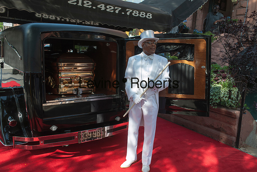 "Isaiah Owens, the owner of Owens Funeral Home, in Harlem in New York poses with his 1924 Roll-Royce hearse prior to a procession, on Friday, June 21, 2013, to the Apollo Theater for a showing of Christine Turner's documentary film ""Homegoings"".  The film features Owens and his funeral home as it studies African-American traditions of death. Owens, who moved to New York in the 1960's, opened the funeral home and with just word of mouth and little advertising has become the paramount funeral home in Harlem, due to his care and understanding.  (© Richard B. Levine)"
