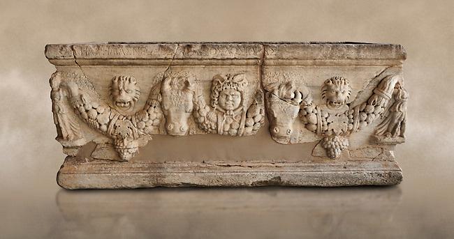 Roman relief sculpted garland sarcophagus, 3rd century AD. Adana Archaeology Museum, Turkey. Against a warm art background