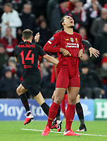11th March 2020; Anfield, Liverpool, Merseyside, England; UEFA Champions League, Liverpool versus Atletico Madrid;  Virgil van Dijk of Liverpool reacts after Marcos Llorente of Atletico Madrid scores  his 105th minute goal which gave  Atletico a 2-3 aggregate lead