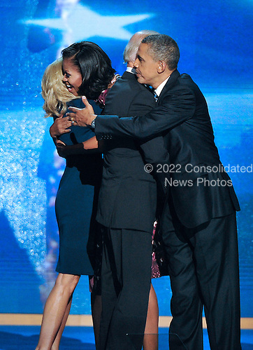 Group hug with United States President Barack Obama, U.S. Vice President Joe Biden, first lady Michelle Obama, and Dr. Jill Biden following the acceptance speeches at the 2012 Democratic National Convention in Charlotte, North Carolina on Thursday, September 6, 2012.  .Credit: Ron Sachs / CNP.(RESTRICTION: NO New York or New Jersey Newspapers or newspapers within a 75 mile radius of New York City)