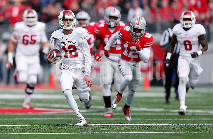Indiana Hoosiers quarterback Zander Diamont (12) runs for a huge gain in the first quarter of the college football game between the Ohio State Buckeyes and the Indiana Hoosiers at Ohio Stadium in Columbus, Saturday afternoon, November 22, 2014. As of half time the Ohio State Buckeyes led the Indiana Hoosiers 14 - 13. (The Columbus Dispatch / Eamon Queeney)