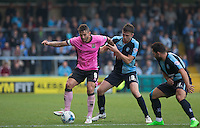 Marc Richards of Northampton Town holds off Dan Rowe of Wycombe Wanderers & Sam Wood of Wycombe Wanderers during the Sky Bet League 2 match between Wycombe Wanderers and Northampton Town at Adams Park, High Wycombe, England on 3 October 2015. Photo by Andy Rowland.